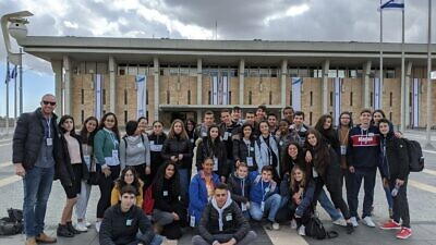 Tevel students outside the Israeli Knesset with Alon Sternberg, far left, the program's director. Photo by Or Tsfati.