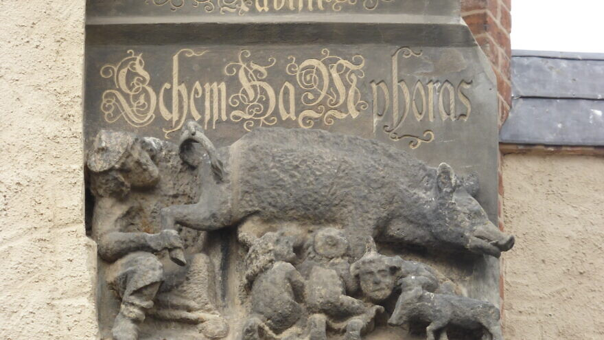 "A view of the anti-Semitic German engraving known as ""Judensau"" on the Wittenberg Parish Church in Germany. Credit: Wikimedia Commons."
