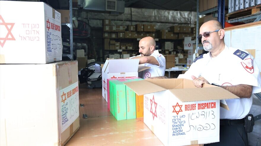 Representatives from the Israeli emergency medical services' organization Magen David Adom pack boxes of protective gear, responding to a request by Chabad to help communities in China amid the coronavirus outbreak, February 2020. Credit: Courtesy.