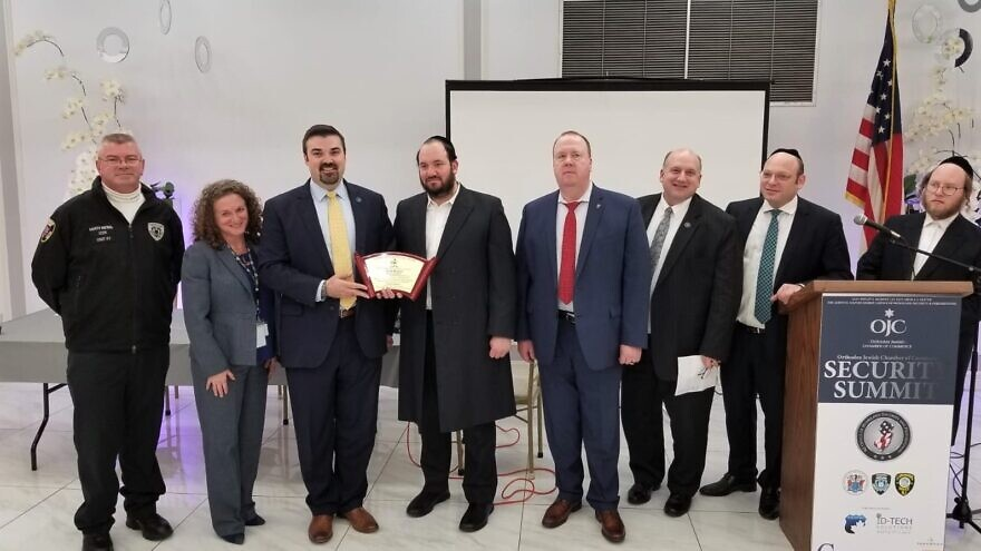 Jared Maples (third from left), the director of the N.J. Office of Homeland Security and Preparedness, accepts an award from a Jewish community leader from Jersey City. Maples spoke at a program on public safety by security officials and law-enforcement experts, Feb. 18, 2020. Credit: Orthodox Jewish Chamber of Commerce.