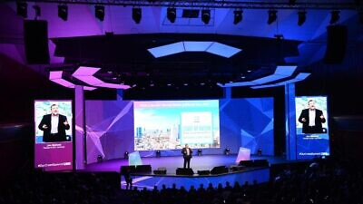 OurCrowd founder and CEO Jonathan Medved speaks to 2,500 people gathered for OurCrowd's 2020 global investor summit in Jerusalem, Feb. 13, 2020. Credit: Courtesy.