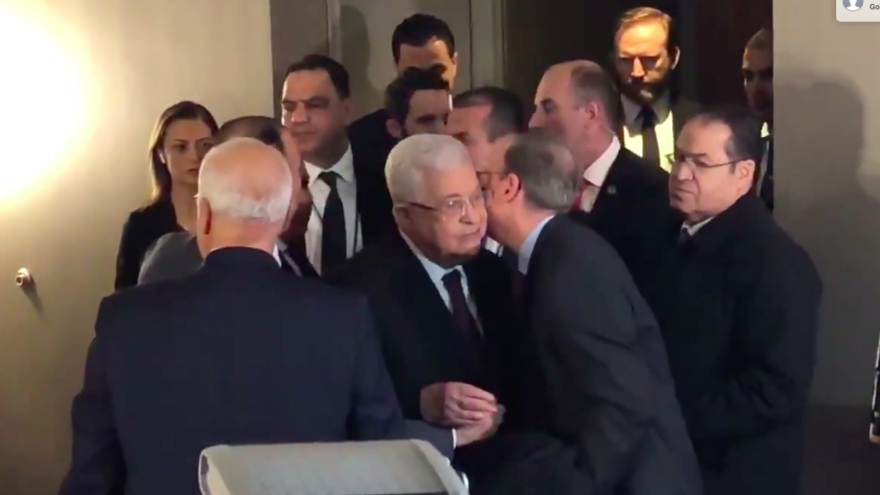 J Street president Jeremy Ben-Ami embraces Palestinian Authority leader Mahmoud Abbas following his making statements at the Grand Hyatt Hotel in Midtown Manhattan on Feb. 11, 2020. Source: Screenshot.