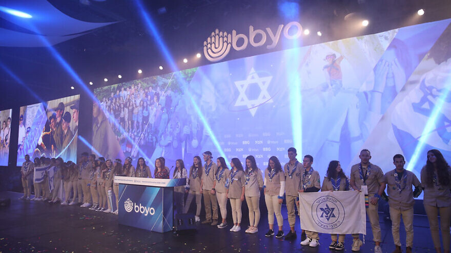 "The Israeli delegation leads attendees in singing Israel's national anthem ""Hatikvah"" at the BBYO International Convention in Dallas, February 2020. Photo by Jason Dixson Photography."