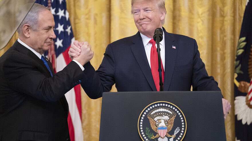U.S. President Donald Trump and Israeli Prime Minister Benjamin Netanyahu shake hands during a press conference announcing the Trump administration's Mideast peace plan on Jan. 28, 2020, in the East Room of the White House. Official White House Photo by Shealah Craighead.