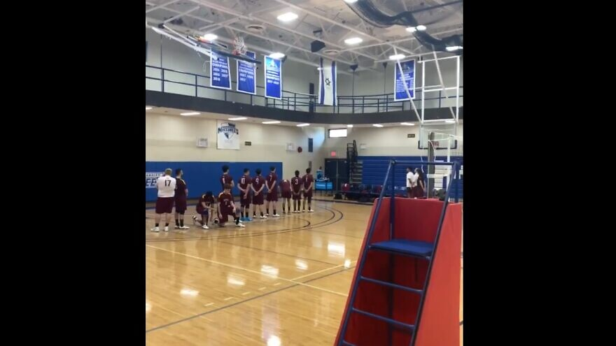 Two Brooklyn College students kneeling during a rendition of Israel's national anthem at a match against Yeshiva University on Feb. 23, 2020. Source: Screenshot.