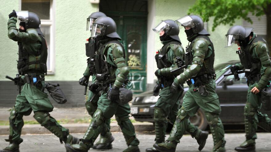 German police on a raid. Credit: Jay P. Lee via Flickr.