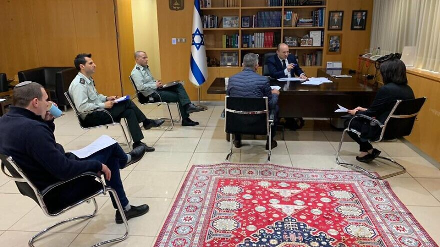 Israeli Defense Minister Naftali Bennett meets with defense officials to discuss new protocols regarding Israelis who have been diagnosed with the coronavirus, COVID-19. Credit: Naftali Bennett via Facebook.