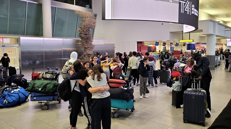 Students from Jewish National Fund-USA's Alexander Muss High School in Israel program bid emotional farewells to each other after landing back in the United States. Credit: Courtesy JNF-USA.