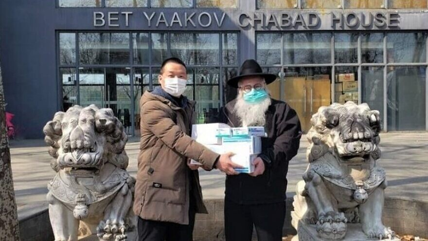 Rabbi Shimon Freundlich has stayed behind in Beijing, China, though his family evacuated to safety overseas. While much of the expatriate Jewish community has left China, Chabad-Lubavitch emissaries are still hard at work, helping local residents. Credit: Chabad.org/News.