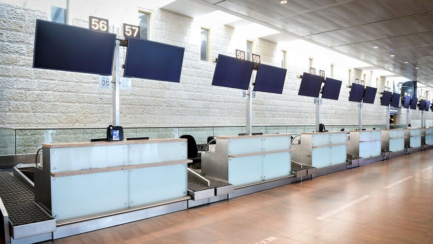 The empty departure hall at the Ben-Gurion International Airport on March 11, 2020. Israeli authorities imposed severe restrictions on all travelers entering Israel, including a two-week home quarantine of all arrivals to prevent the spread of coronavirus. Photo by Flash90.