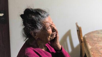 A homebound elderly woman in Israel feeling the isolation. Credit: IFCJ.