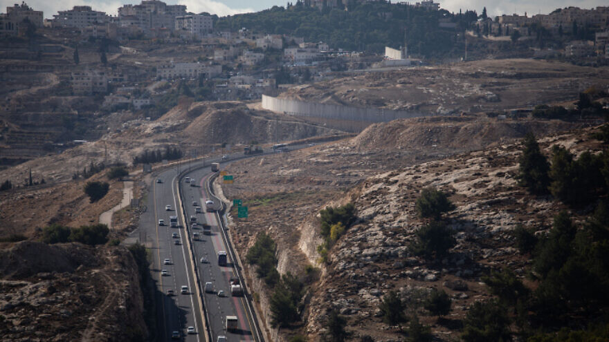 A view of Highway 1, the Ma'aleh Adumim-Jerusalem road, from the West Bank area known as E1, with Jerusalem's Mount Scopus seen on the horizon, Dec. 10, 2019. Photo by Hadas Parush/Flash90.