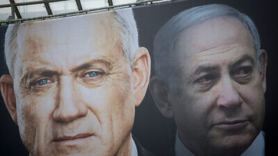 Blue and White Party election posters show leader Benny Gantz and Likud head Israeli Prime Minister Benjamin Netanyahu ahead of Israel's third round of elections within a year, Feb. 18, 2020. Photo by Miriam Alster/Flash90.