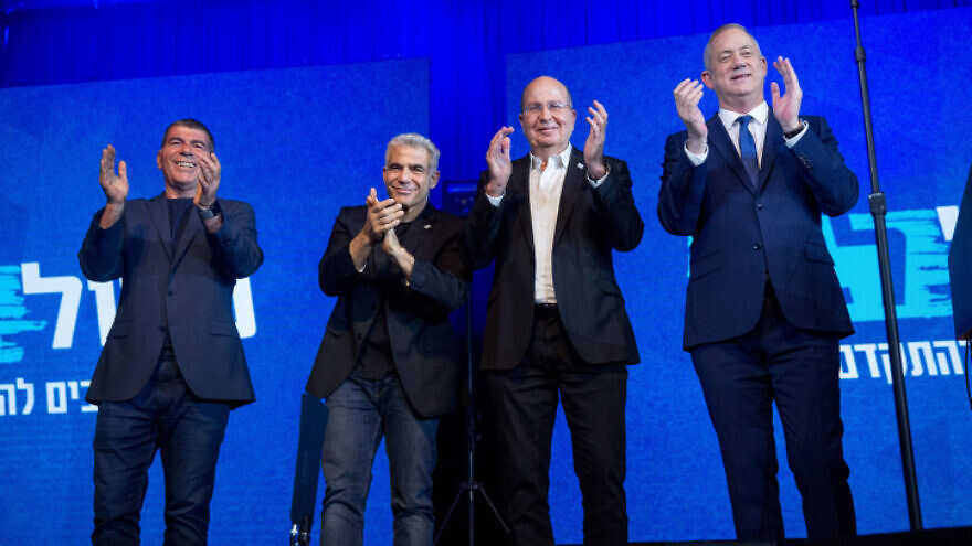 Blue and White Party leder Benny Gantz (far right) with party co-leaders Moshe Ya'alon (second from right), Yair Lapid (second from left) and Gabi Ashkenazi, at party headquarters in Tel Aviv, on election night, March 3, 2020. Photo by Miriam Alster/Flash90.