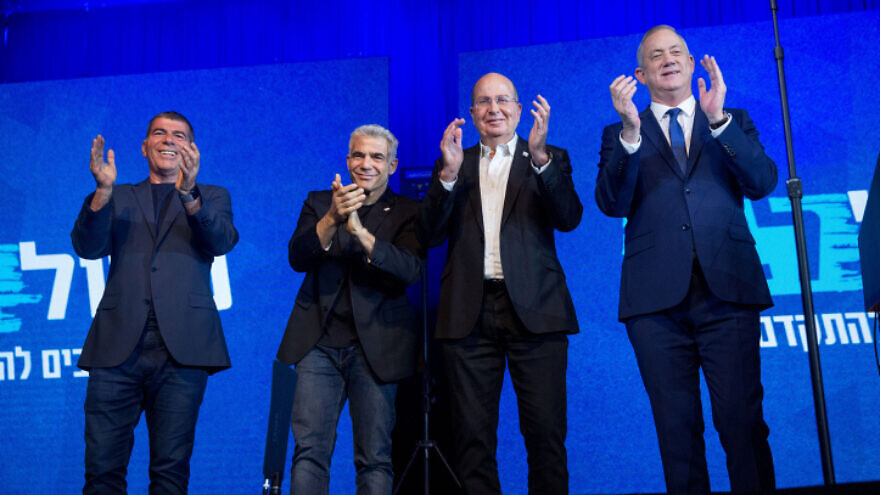 Blue and White Party leader Benny Gantz (far right) with top party members in Tel Aviv on election night after Israel's third round of general elections within a year, March 3, 2020. Photo by Miriam Alster/Flash90.