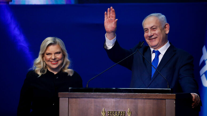 Israeli Prime Minister Benjamin Netanyahu and his wife, Sara, address their supporters on Israeli election night at Likud Party headquarters in Tel Aviv, March 3, 2020. Photo by Olivier Fitoussi/Flash90.