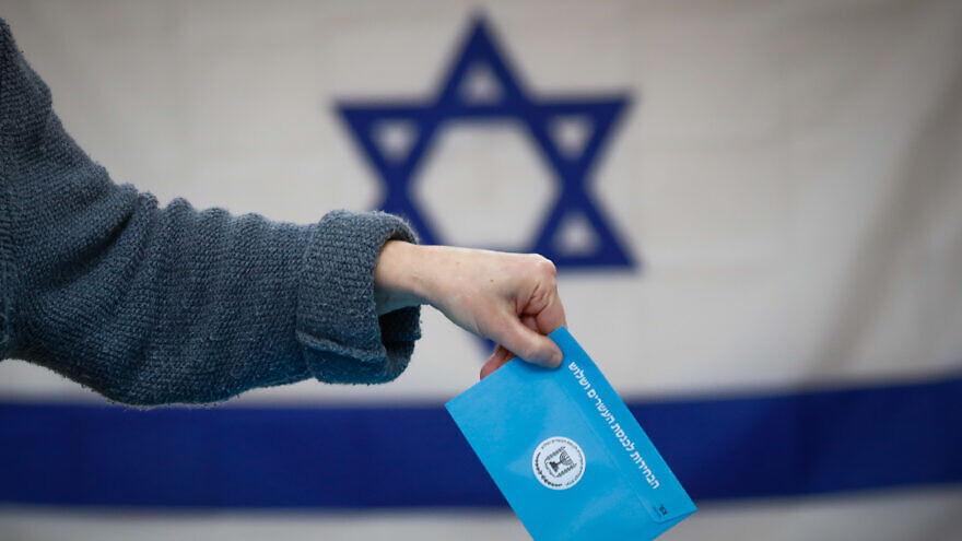 Israelis cast their ballots at a voting station in Jerusalem during the third round of elections on March 2, 2020. Photo by Olivier Fitoussi/Flash90.