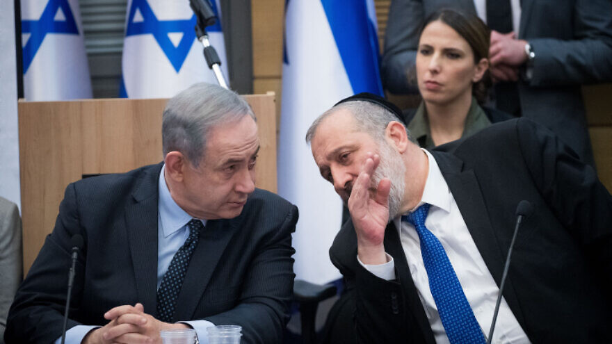 Israeli Prime Minister Benjamin Netanyahu speaks with Shas Party chairman Aryeh Deri during a meeting with the heads of the right-wing parties on March 4, 2020. Photo by Yonatan Sindel/Flash90.