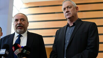 Yisrael Beiteinu leader Avigdor Lieberman (left) and leader of the Blue and White Party Benny Gantz hold a joint statement after their meeting in Ramat Gan on March 9, 2020. Photo by Tomer Neuberg/Flash90.