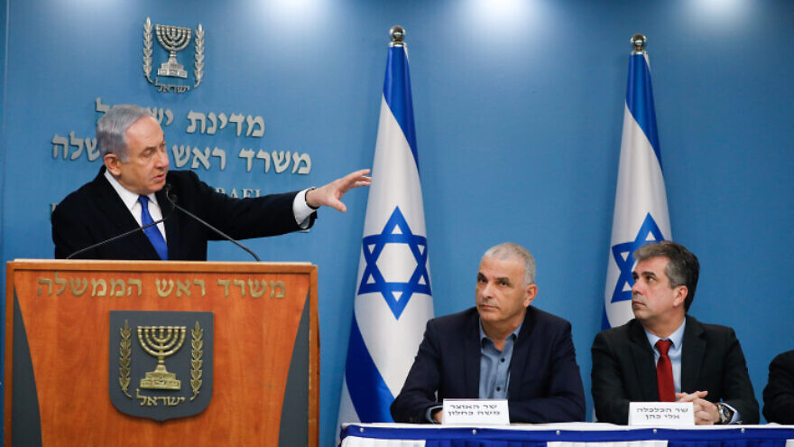 Israeli Prime Minister Benjamin Netanyahu holds a press conference with Finance Minister Moshe Kahlon, Economics Minister Eli Cohen and Bank of Israel head Amir Yaron (not pictured) on economic preparations for the financial fallout of the COVID-19 crisis, March 12, 2020. Photo by Olivier Fitoussi/Flash90.