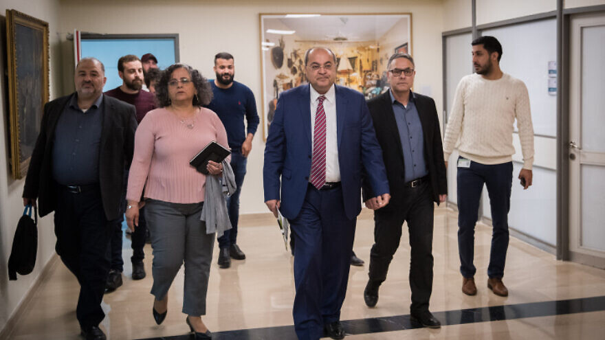 Joint Arab List leader Ahmad Tibi arrives at the Knesset in Jerusalem for talks with representatives of the Blue and White Party, on March 11, 2020. Photo by Yonatan Sindel/Flash90.