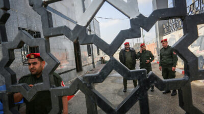 Palestinian security forces loyal to Hamas stand at the Rafah border crossing with Egypt in the southern Gaza Strip on March 15, 2020. Photo by Abed Rahim Khatib/Flash90.