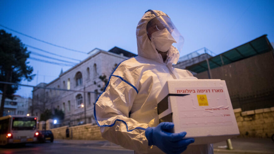 A Magen David Adom worker on the way to test a patient with symptoms of the coronavirus in Jerusalem, March 16, 2020. Photo by Yonatan Sindel/Flash90.