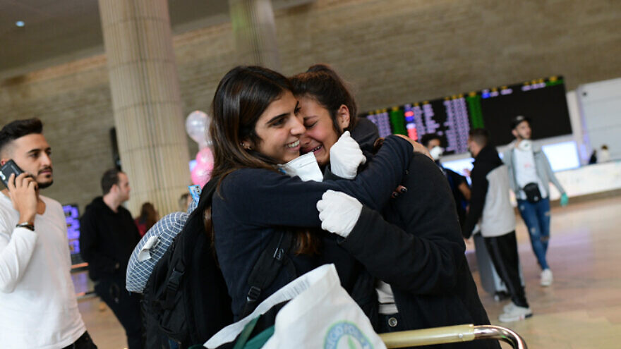 Israelis arrive at Ben-Gurion International Airport in Tel Aviv from South America, where they were temporarily stranded as a result of the coronavirus epidemic, on March 20, 2020. Photo by Tomer Neuberg/Flash90.