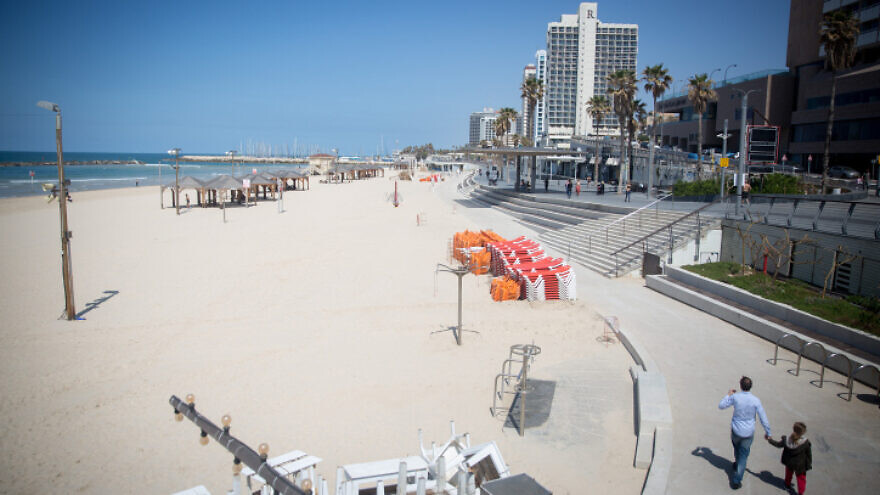 The nearly empty beach in Tel Aviv. Daily life has come to nearly a complete standstill as the number of coronavirus cases in Israel continues to rise, March 25, 2020. Photo by Miriam Alster/Flash90.