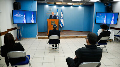 Israeli Prime Minister Benjamin Netanyahu gives a press conference about the coronavirus outbreak at the Prime Minister's Office in Jerusalem on March 25, 2020. Photo by Olivier Fitoussi/Flash90.