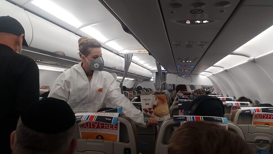 Some 200 Israelis flying home after being stranded abroad due to the coronavirUs (COVID-19) got a pre-taste of the Passover holiday in the form of boxes of round, handmade shmurah matzah, March 26, 2020. .Credit: EMIH.