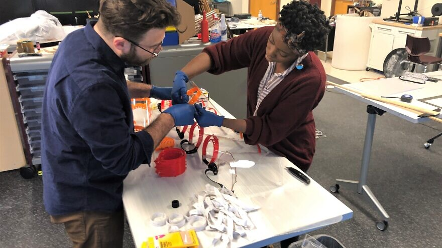 Art teacher Daniel Ostrov and Stephanie Cole work making protective face shields for medical professionals using 3D printers in the school's Fabrication Laboratory at Kohelet Yeshiva High School in Merion Station, Pa., March 2020, Credit: Courtesy.