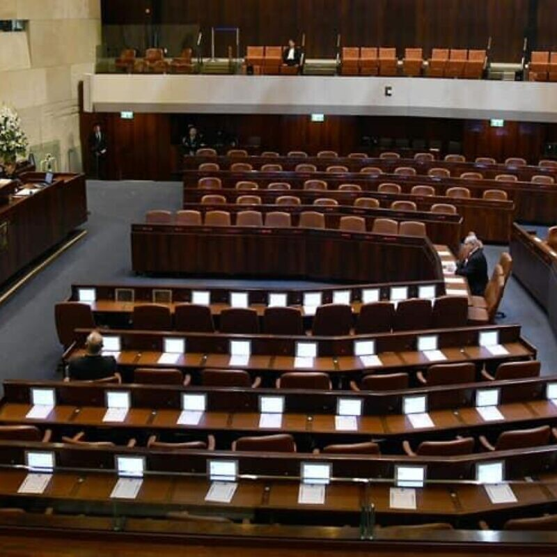 Israeli President Reuven Rivlin addresses a largely empty Knesset on the occasion of the swearing-in of the 23rd Knesset. Present is Israeli Prime Minister Benjamin Netanyahu, Blue and White leader Benny Gantz, Knesset speaker Yuli Edelstein and Supreme Court president Esther Hayut on March 16, 2020. Photo by Haim Zach/GPO.