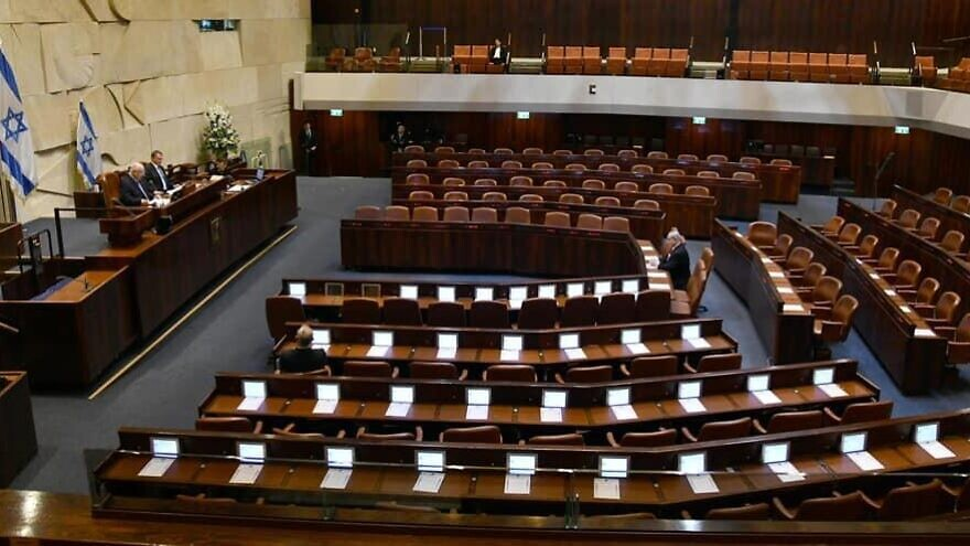 Israeli President Reuven Rivlin addresses a largely empty Knesset on the occasion of the swearing-in of the 23rd Knesset. Present is Israeli Prime Minister Benjamin Netanyahu, Blue and White leader Benny Gantz, Knesset speaker Yuli Edelstein and Supreme Court president Esther Hayut. Photo by Haim Zach/GPO.