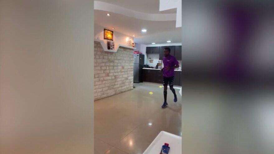 Israeli runner Gazcho Fanta completes a marathon in his living room while on coronavirus lockdown. Source: Screenshot.