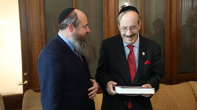 Rabbi Menachem Even-Israel, the son of Rabbi Adin Even-Israel Steinsaltz, presents the first volume of the Steinsaltz Talmud to Rep. Eliot Engel (D-N.Y.). Credit: The Aleph Society.