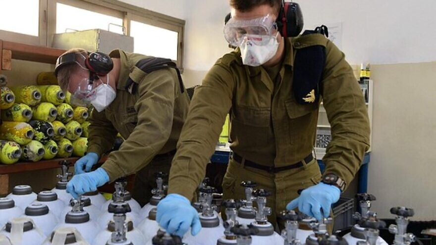Israel Defense Forces' soldiers help fill and deliver oxygen tanks as part of the country's efforts to combat the coronavirus pandemic. Credit: IDF Spokesperson's Unit.