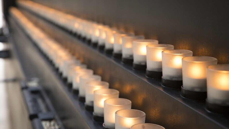 Candles lit in remembrance of the Holocaust. Credit: U.S. Holocaust Memorial Museum.