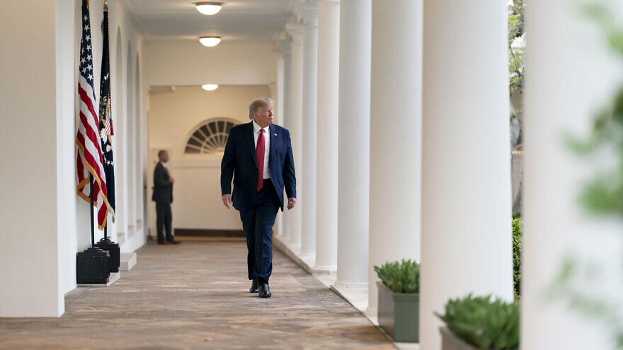 U.S. President Donald Trump returns to the Oval Office following a White House Coronavirus Task Force update briefing on March 29, 2020, at the White House. Official White House Photo by Andrea Hanks.