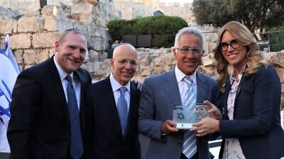 From left: Nefesh B'Nefesh co-founder and executive director Rabbi Yehoshua Fass, NBN co-founder Tony Gelbart and Sylvan Adams with 2019 Bonei Zion Young Leadership recipient Miriam Ballin. Photo by Sasson Tiram.