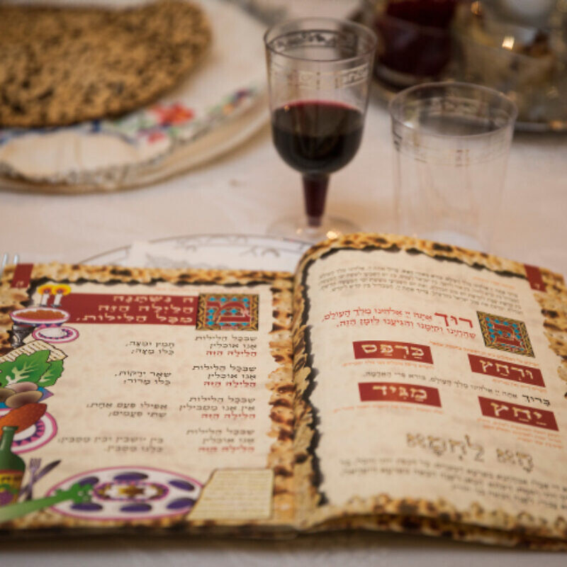 A Passover Haggadah on the eve of the Jewish holiday of Passover, April 22, 2016. Photo by Hadas Parush/Flash90.