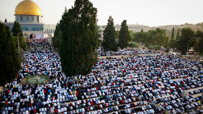 Muslims pray in front of the Dome of the Rock at the Al-Aqsa Mosque in Jerusalem during the Muslim holiday of Eid al-Fitr, marking then end of the month of Ramadan, June 5, 2019. Photo by Sliman Khader/Flash90.
