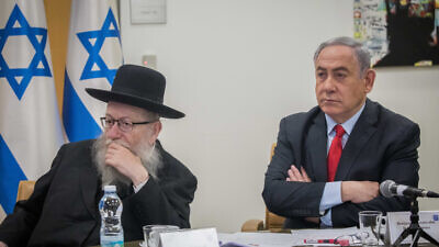 Israeli Prime Minister Benjamin Netanyahu and Health Minister Yaakov Litzman hold a video conference at the Foreign Ministry in Jerusalem with European leaders to discuss government responses to the coronavirus pandemic, March 9, 2020. Photo by Yonatan Sindel/Flash90.