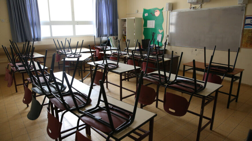An empty classroom in the northern Israeli city of Tzfat, on March 13, 2020. Schools across the country have been shuttered as a preventive measure against the spread of the coronavirus. Photo by David Cohen/Flash90.