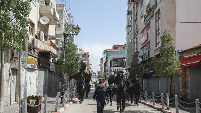 Palestinian Authority security forces patrol the empty streets of Ramallah in the West Bank, on March 23, 2020. Photo by Flash90.