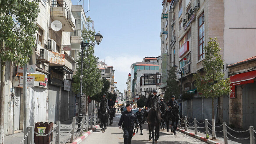 Palestinian Authority security forces patrol the empty streets of Ramallah in the West Bank on March 23, 2020. Photo by Flash90.
