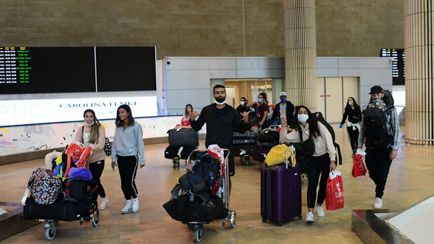 Israelis who had been stranded in South America by the coronavirus pandemic arrive at Ben Gurion Airport near Tel Aviv on March 23, 2020. March 20, 2020. Photo by Tomer Neuberg/Flash90.