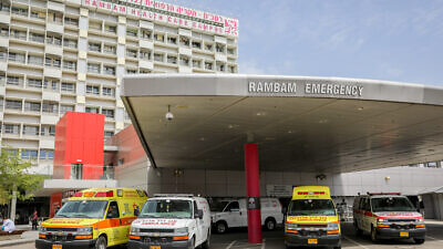 Ambulances outside the Rambam Rambam Healthcare Campus in Haifa in Haifa, on March 30, 2020. Photo by Yossi Aloni/Flash90.