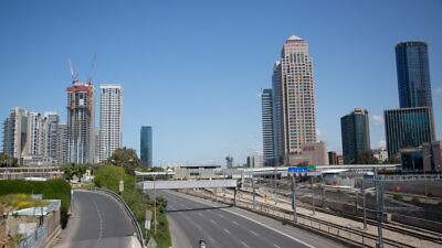 The empty Ayalon highway in Tel Aviv on April 8, 2020. All intercity travel has been banned until after the first days of Passover. Photo by Miriam Alster/Flash90.