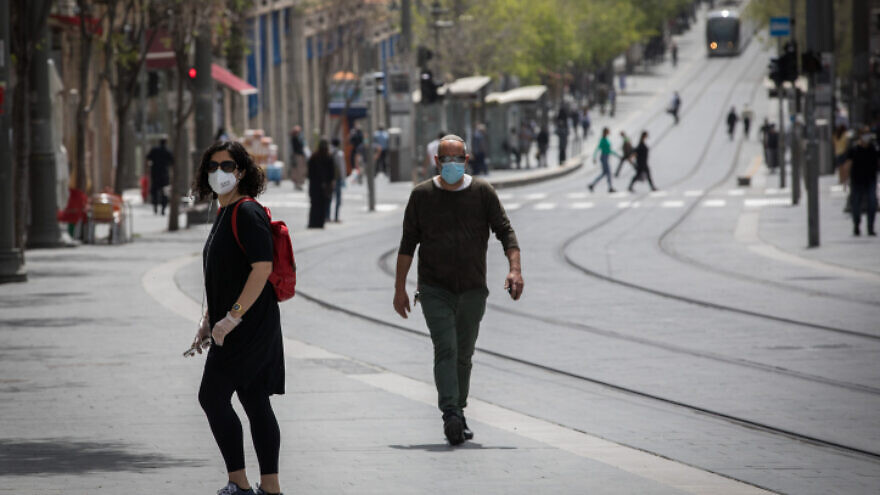 People walk on Jaffa Street in downtown Jerusalem on April 19, 2020. Photo by Nati Shohat/Flash90.